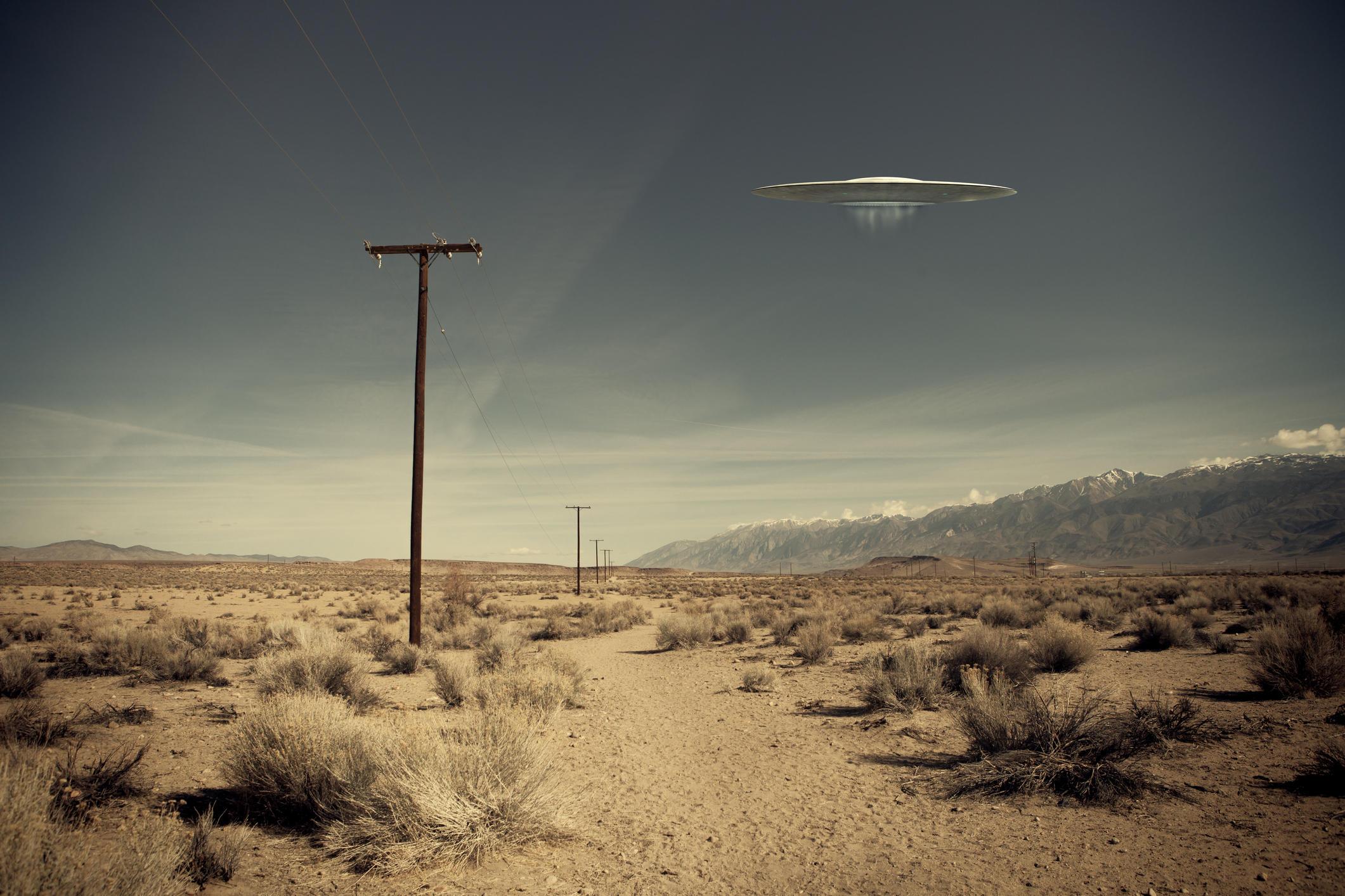 UFO over desert road