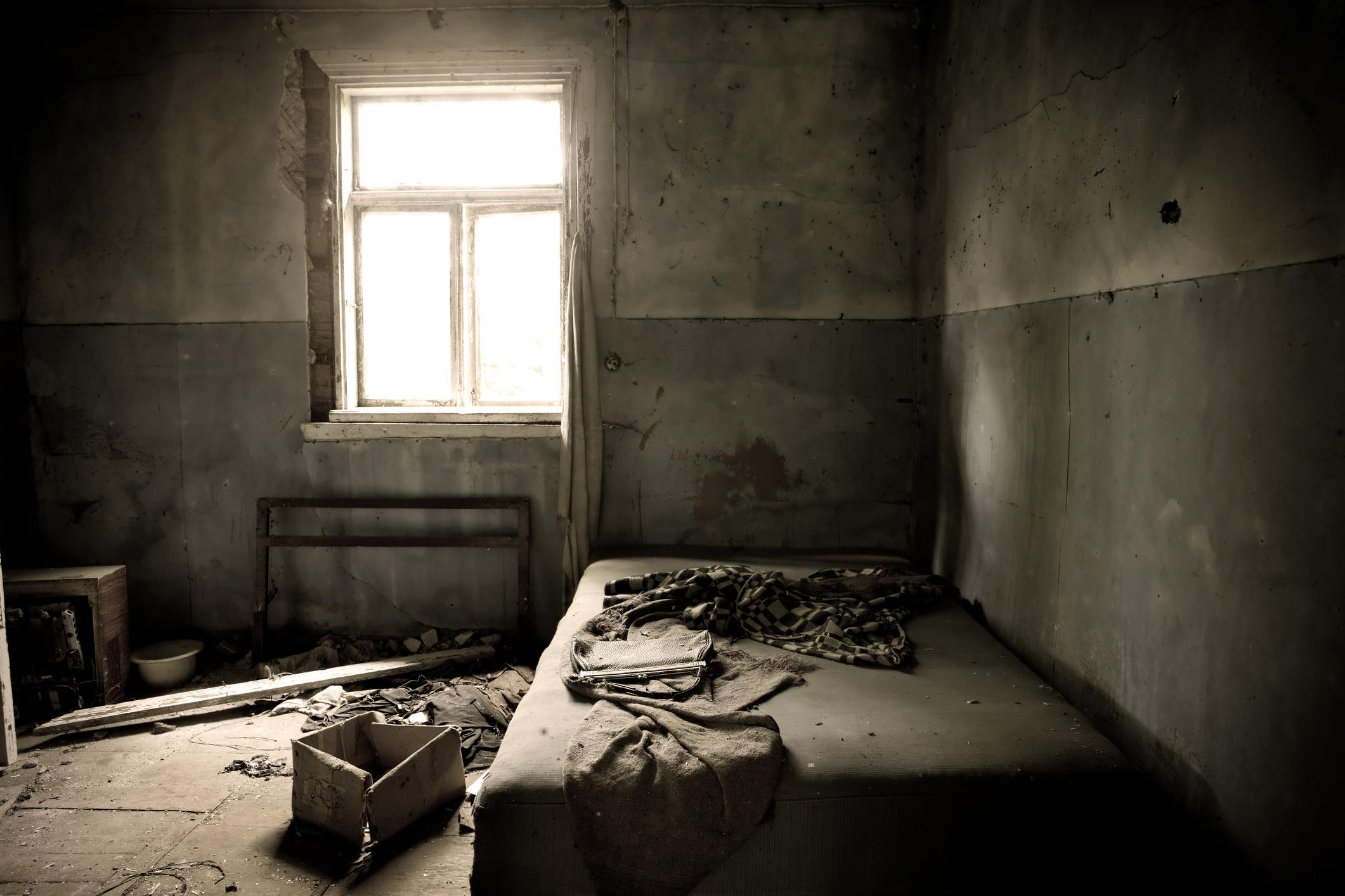A dark moldy old abandoned bedroom