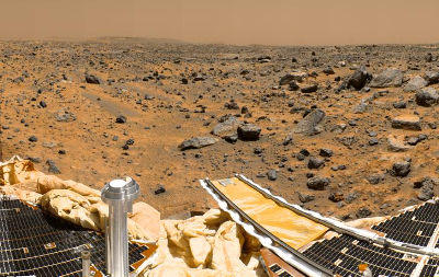 In 1997, the world was summarily astounded by the landing on Mars -- on July 4th, no less -- of NASA's Pathfinder spacecraft. Using a never-before-deployed airbag landing system, the craft bounced to a halt on the red planet and then deployed the Sojourner rover. The Pathfinder mission managed to live until the end of September 1997. Sojourner analyzed the Martian rocks, atmosphere and climate, and into the bargain it was a low-cost success for NASA. In this picture, we see a color-enhanced shot of the Martian landscape taken by the Pathfinder imager. The first pictures sent back of the barren red planet caused a sensation worldwide. In the next photo, see how another NASA rover showed the red of the red planet.