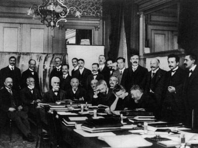 The international physics conference that was convened in Brussels by Belgian chemical magnate Ernest Solvay in 1911 was perhaps the most formidable gathering of scientists ever. Most of those pictured are Nobel laureates. Left to right, standing: Victor Goldschmidt, Max Planck, Rubens, Somerfeld, Lindemann, Louis Victor De Broglie, Knudsen, Hasenohrl, Hostelet, Herzen, James Hopwood Jeans, Ernest Rutherford, Heike Kamerlingh-Onnes, Albert Einstein and Paul Langevin. Left to right, seated at table: Walther Nernst, Marcel Louis Brillouin, Ernest Solvay, Hendrik Lorentz, Otto Heinrich Warburg, Jean Baptiste Perrin, Wilhelm Wien, Madame Marie Curie and Jules Henri Poincare..