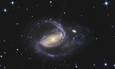 Like most galaxies, NGC 1097, a barred spiral galaxy, has a supermassive black hole at its center. The next image is a new Hubble photo showing another black hole at the center of a galaxy.
