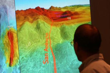 Brad Aagaard, a research geophysicist with the U.S. Geological Survey, looks at illustrations of how a high-magnitude earthquake on the San Andreas Fault in California could cause devastation across the southern part of the state.