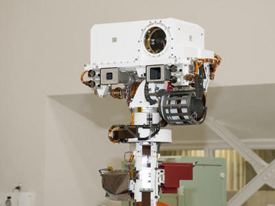 This handsome face is the sensing unit Curiosity will use to navigate its surroundings. The two square openings are a telephoto camera (left) and a wide-angle camera that shoot full-color, high-definition video. The smaller circles next to them are a stereo navigation camera and a twin for backup. The big circle in the white box at the top is ChemCam, short for Chemistry and Camera. This device combines a laser and a telescope, and can determine what's in a rock 23 feet (7 meters) away.