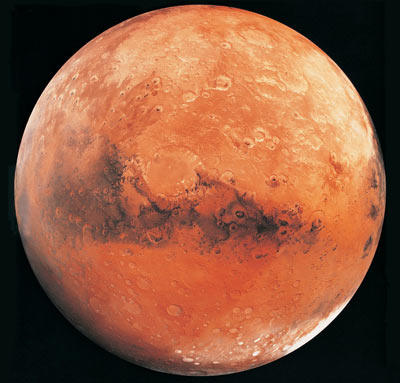 Here we see why Mars is commonly referred to as the red planet. An image of Mars that was taken from NASA's Hubble space telescope is featured on the next page.