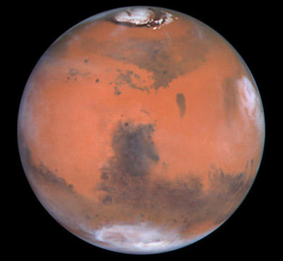 This image of Mars was taken by the Hubble Space Telescope. To see pictures of the surface of Mars, check out the next few pages.