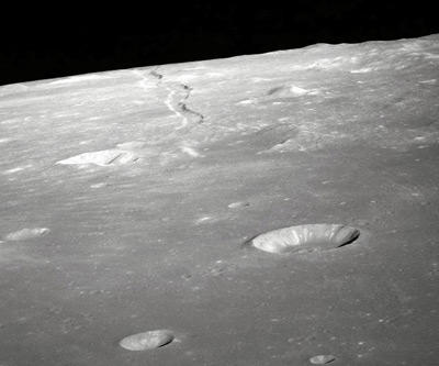 This May 1969 view of the lunar surface comes courtesy of Apollo 10. It was the first manned mission to orbit the moon, and was NASA's final test run for the moon landing later that year. The snake-like trough in the upper part of the frame is Rima Ariadaeus, a type of lunar groove called a rille. It may represent a fault line in the moon's structure. To see one of the most important achievements in human history, check out the next picture.