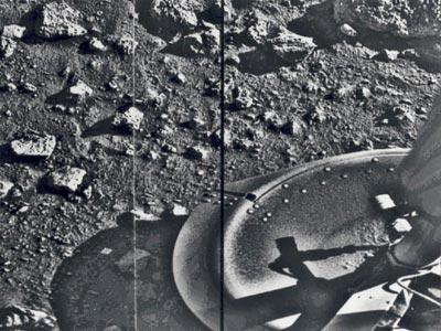"You are looking at the first photograph ever taken on a planet other than Earth. This image was captured July 20, 1976 by the Viking 1 lander shortly after touching down on the Martian surface. Viking 1 and Viking 2 were twin craft that each combined an orbiter and a lander. Designed to work for just 90 days on Mars, both Vikings succeeded well beyond researchers' expectations. The Viking 1 lander transmitted data until November 1982, more than two years after Viking 2 lander ceased operation. The landers collected data on the composition of Martian soil and atmosphere, and began NASA's on-site search for life on Mars. ""The Viking mission looms like a legendary giant, an incredible success against which all present and future missions will be measured,"" NASA Mars Exploration Program Director Doug McCuiston said, on the occasion of the 30th anniversary of the Viking program in 2006. Next we'll see an image from one of NASA's first low-cost Mars lander spacecraft."