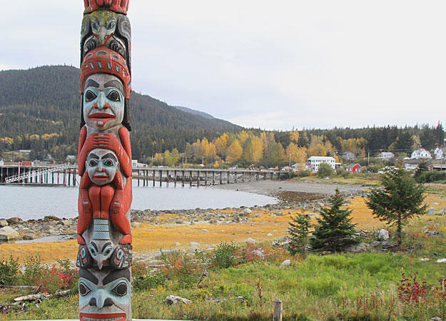 A Tlingit totem standing on the outskirts of Haines, Alaska symbolizes the rich Native American history of the region. The Tlingit reaped bountiful fish harvests from the Chilkat waters for centuries and during the early 1900's, a thriving fish canning industry grew up around Haines. Commercial fishing faded decades ago but the area's pristine beauty, natural wonders and rich history continue to attract thousands of visitors and adventurers.