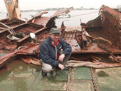 The wreck of the Titanic was finally discovered in 1985; since that time, people have been recovering artifacts of all kinds. In this photo, RMS Titanic, Inc., general counsel Allan Carlin poses with a 20-ton piece of the Titanic's hull that has been hauled to the surface.