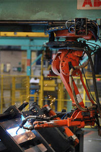 We don't mean to malign the world's hard-working industrial robots, which often perform tasks too dangerous or repetitive for the typical person. This robot arm is welding bridge components at the Mabey Bridge factory in Gloucester, England. The bridges under construction are being sent to flood-ravaged areas of Pakistan.