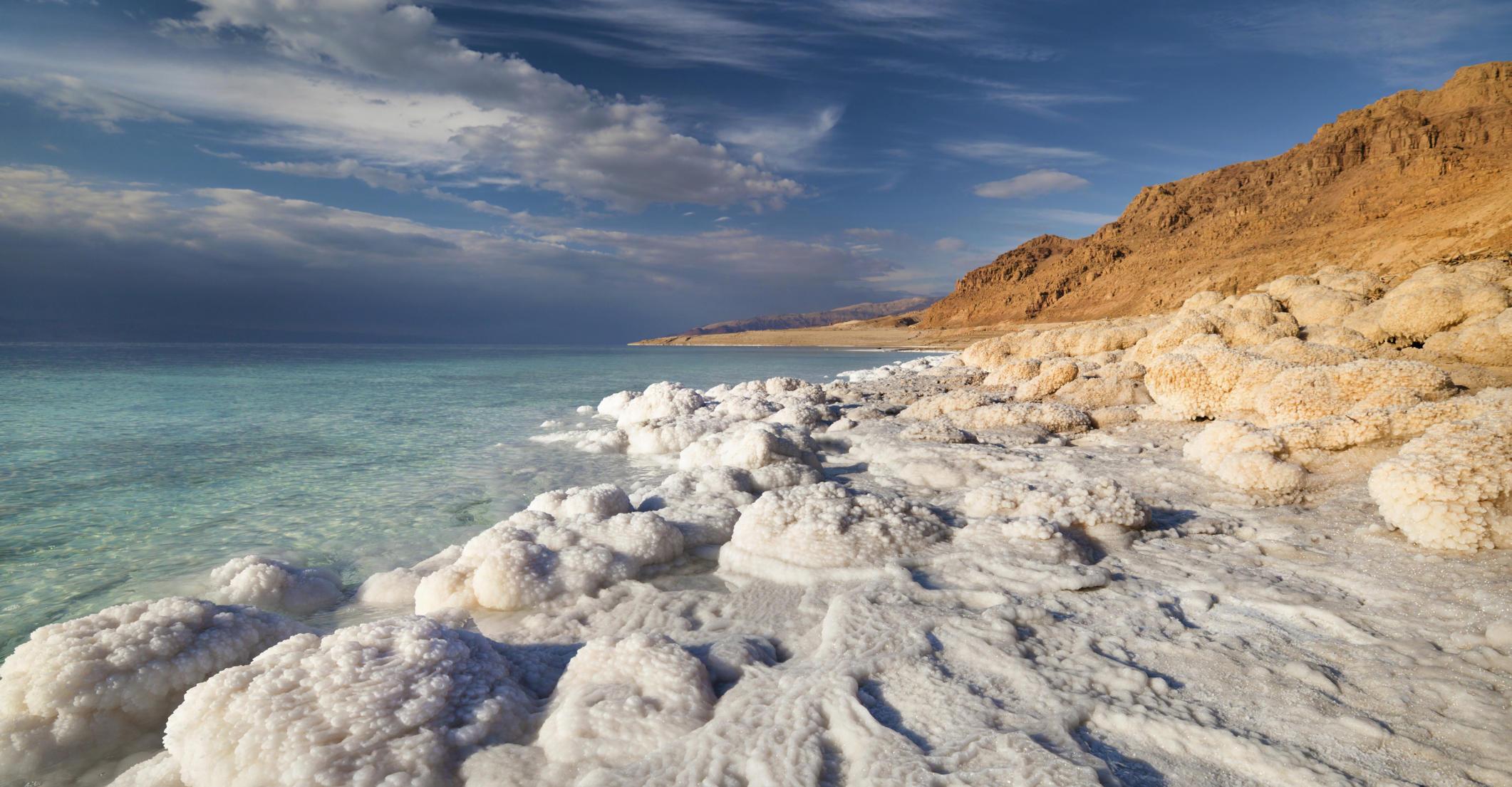 Dead Sea coastline at sunset time