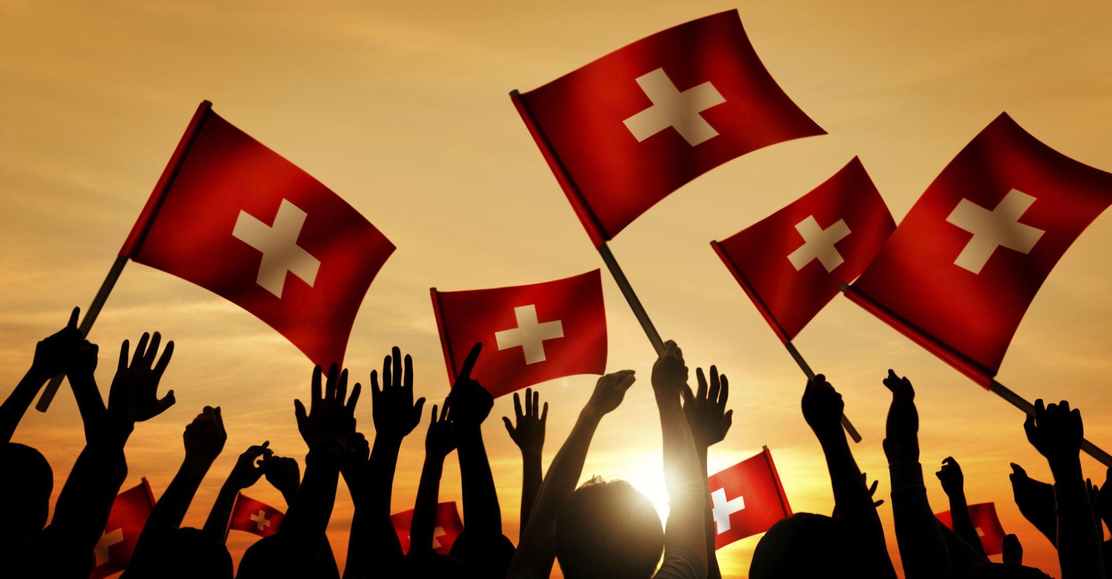 People waving Swiss flag