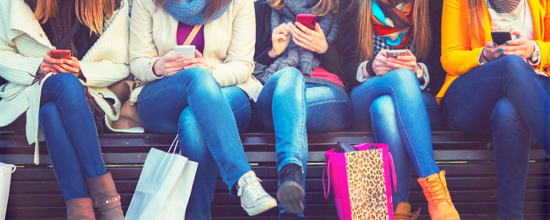 Group of friends using smartphones