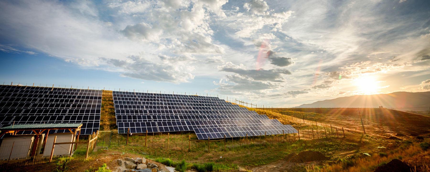 Solar panels against sunset