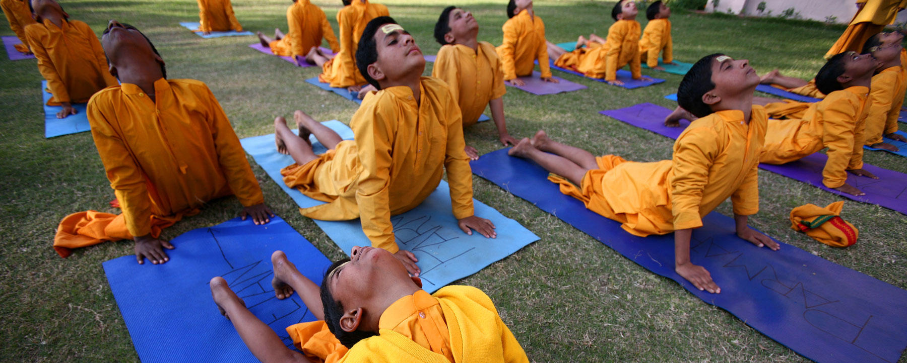 Boys at daily yoga session at Gurukul school of Parmarth Niketan in Rishikesh, India.