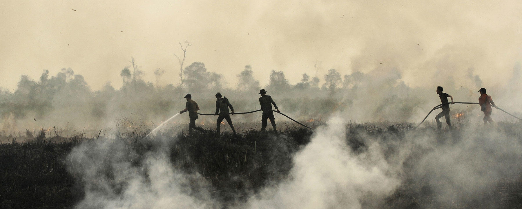 Indonesian fire fighters put out a fire in Ogan Ilir, South Sumatra.