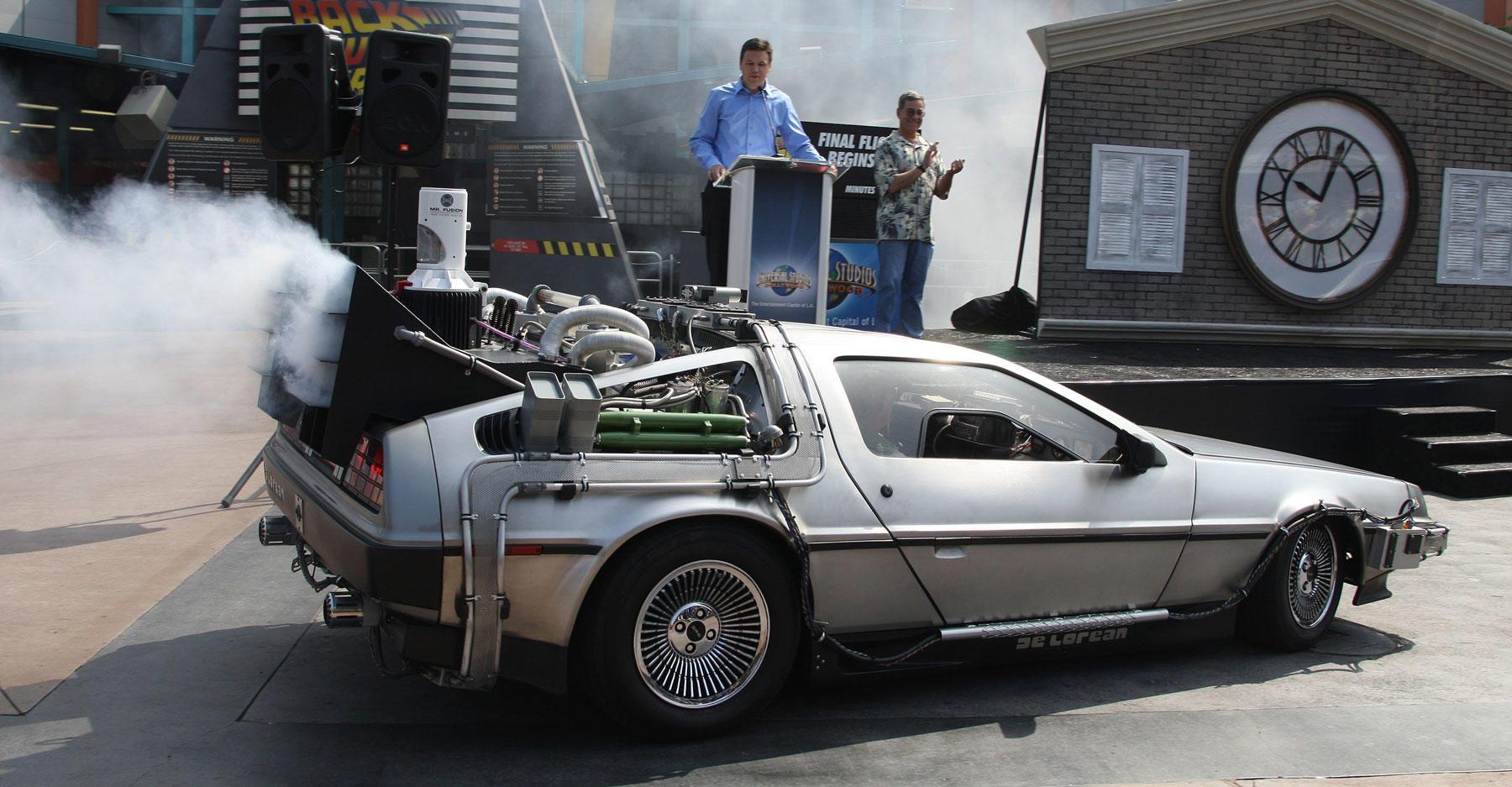 Christopher Lloyd arrives in a DeLorean