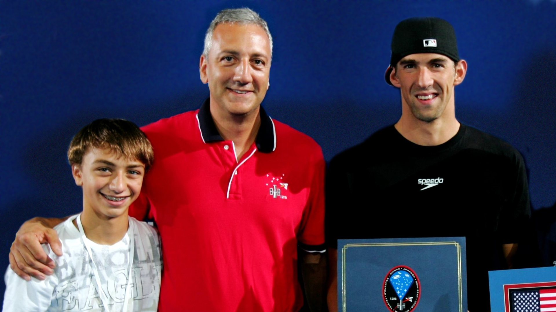 Mike Massimino and Michael Phelps