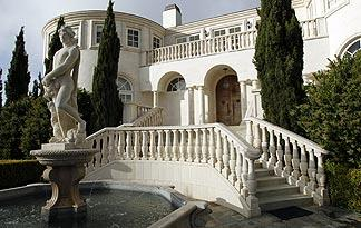 behind-mansion-walls-about-324x205