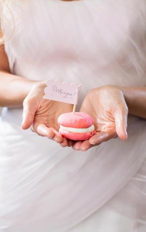 Custom-made pink whoopie pies make sweet wedding favors.