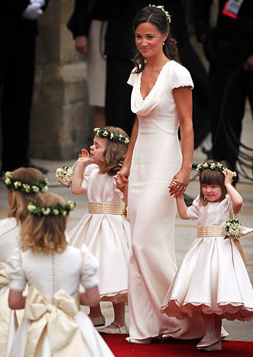 Pippa also opted to mimic Kate with a half-up hairstyle with Lily of the Valley flowers as a hairpiece.