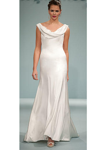Body-skimming fabric makes this gown effortlessly sexy; the wide cowl neck that covers the shoulders keeps it venue-appropriate.