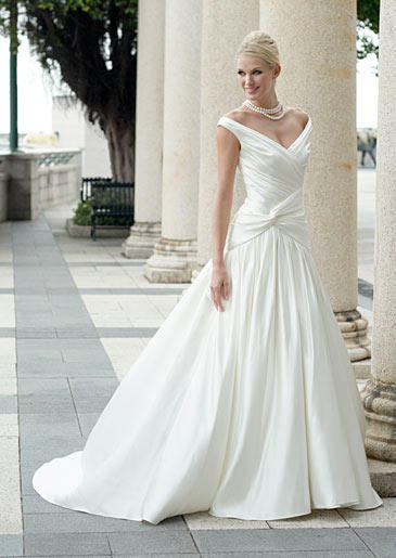 The ruched bodice and off-the-shoulder straps of this dropped-waist ball gown keep a timeless design fashion-forward.