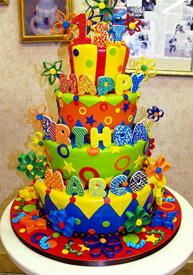 One-year-old Marco gets a four-tiered explosion of color of taste on his birthday.
