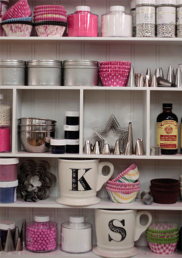 Colorful cupcake liners, decorating tools and sweet ingredients line the shelves at Georgetown Cupcake.