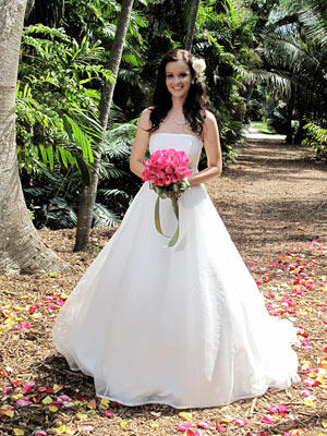 This classic princess ball gown has a straight neckline and wide skirt with subtle tulle overlay.