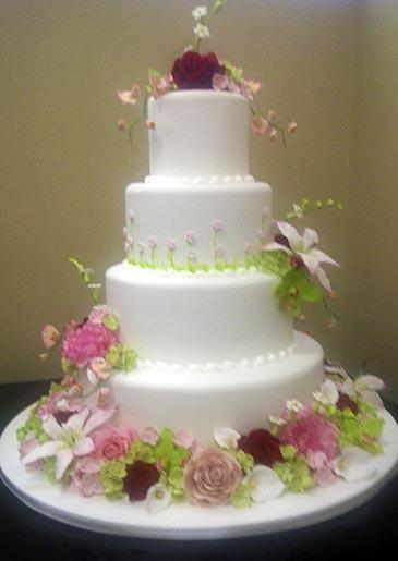 A four-tiered cake with floral details, seen at Lackawanna.