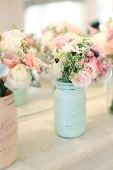 In another variation of the Mason jar vase, these are painted pretty pastels for a spring wedding.