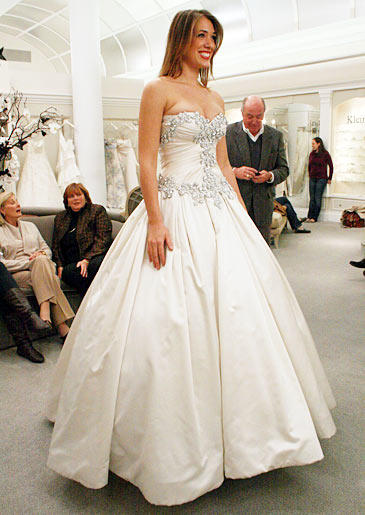 The Rich Daddy's Girl: A dad isn't going to drop 10 grand on a dress for his daughter if he thinks the dress is too sexy or revealing. Saying yes to the dress before dad agrees to pay? That's a risky tactic, but it worked for Liz!