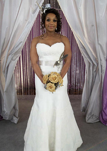 This bride accents her white lace fit and flare with a pewter sash.