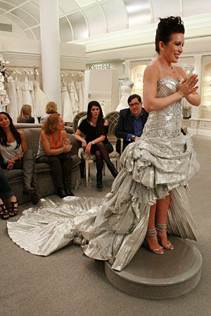 This unforgettable Pnina Tornai design doesn't come cheap (the bride here paid $34,000 for the dress), but it makes a strong statement.
