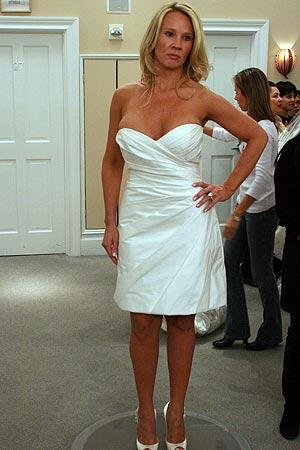 A smoking hot satin V-neck minidress is a popular choice among encore and destination brides.