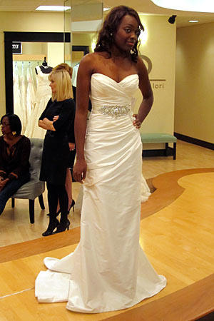 This white satin sheath with sweetheart neckline makes the bride look especially willowy.
