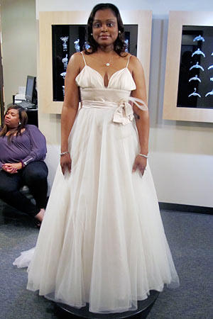 Very thin straps support a deep sweetheart neckline on this whisper-pink gown.