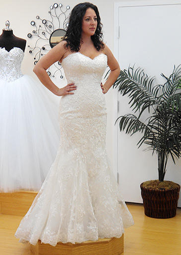Bright white lace and a sweetheart neckline play up this bride's curves.
