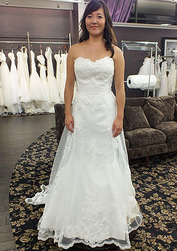 This A-line gown with lace-embroidered overlay and sweetheart neckline is well-suited for spring and summer weddings.