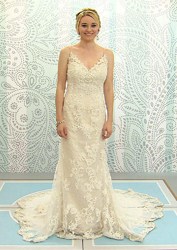 This intricate lace sheath has a plunging V-neck and very thin straps.