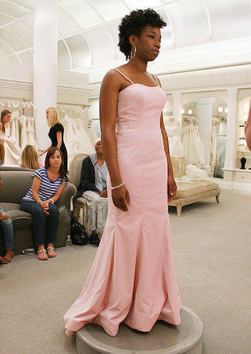 A bubble gum pink sheath with spaghetti straps can be styled with a veil and crystal accessories for the ceremony, or dressed down for a casual reception.