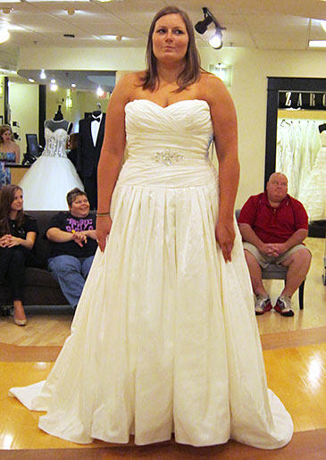 This white A-line gown works for large-busted brides because a ruched bodice offers extra support.