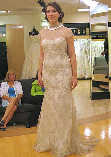 A champagne lace overlay and illusion neckline make this style sophisticated for a simple fall or winter wedding.