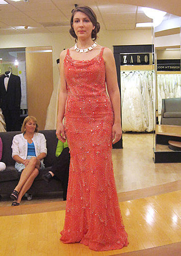 A bright coral beaded sheath is chic enough for a wedding in the city, yet beachy enough for a destination wedding.