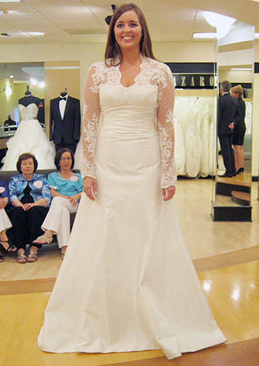 An ivory A-line gown with lace sleeves recalls Kate Middleton's famous wedding dress.