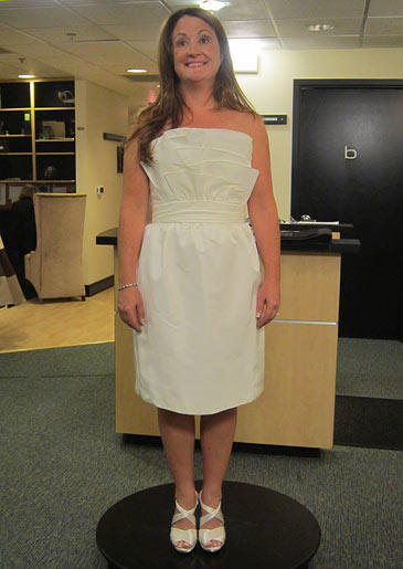 A simple short sheath in ivory is appropriate for an encore wedding or for a reception dress.