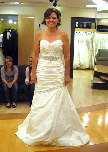 Mature brides can wear white, too. A white satin fit and flare is all glamour -- and for all ages.