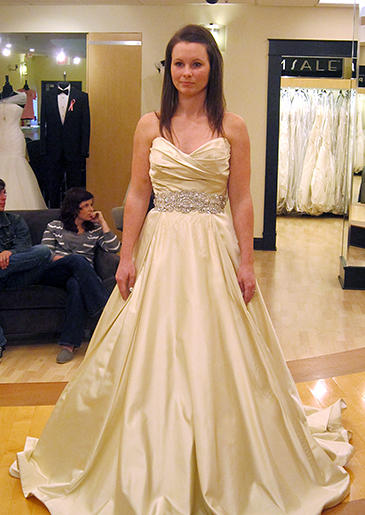 This luminous champagne ball gown has an antique quality to its color.