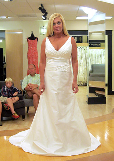 An unfussy white A-line gown with plunging V-neck is perfect for an encore or mature bride.